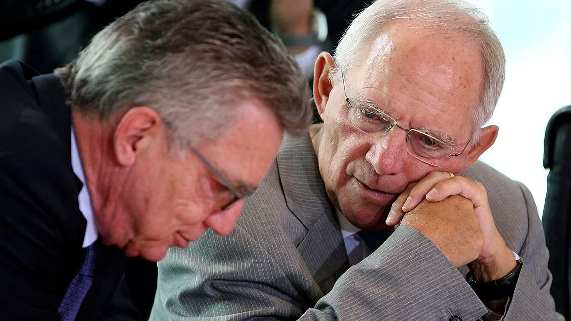Thomas de Maizière (l.) und Wolfgang Schäuble  Foto: Reuters