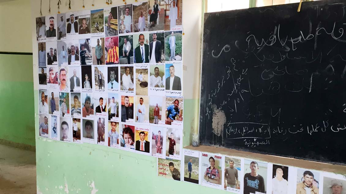 Kozo: Fotos von Massaker-Opfern.