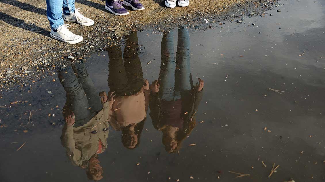 Drei Menschen