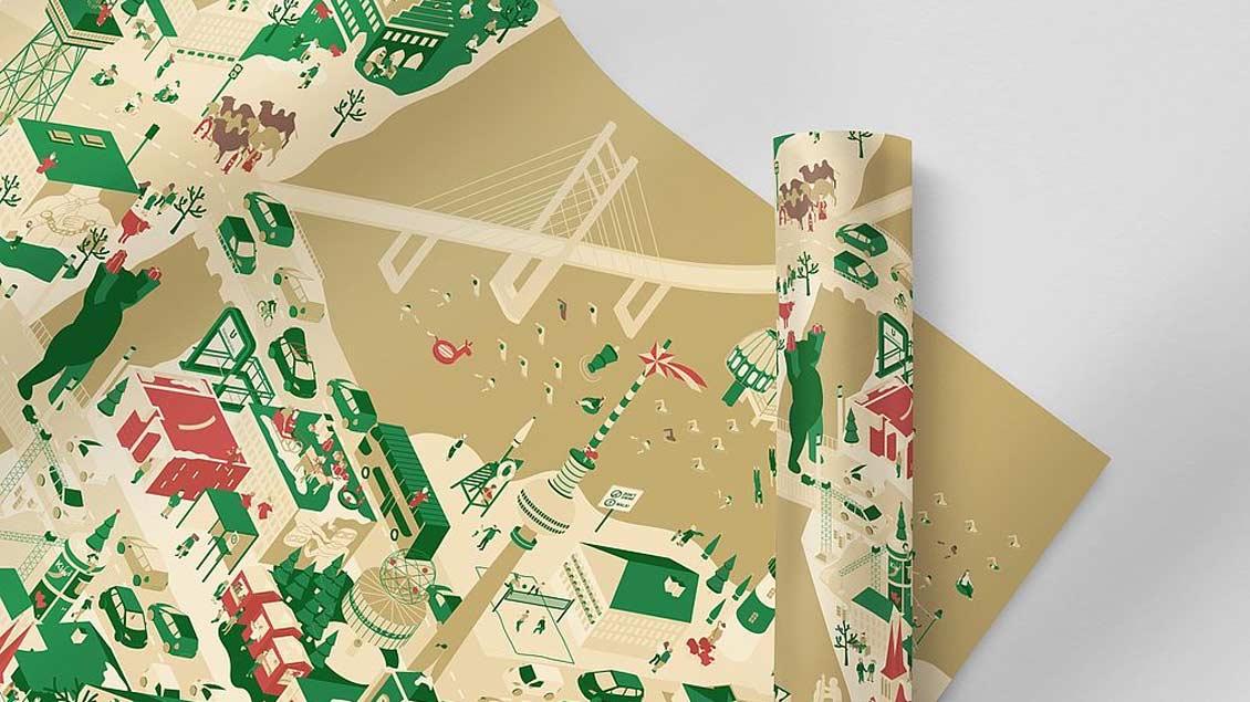 Das eigens entworfene Geschenkpapier des Erzbistums Berlin zeigt irgendwo im Wimmelbild die heilige Familie mitten in der Hauptstadt.