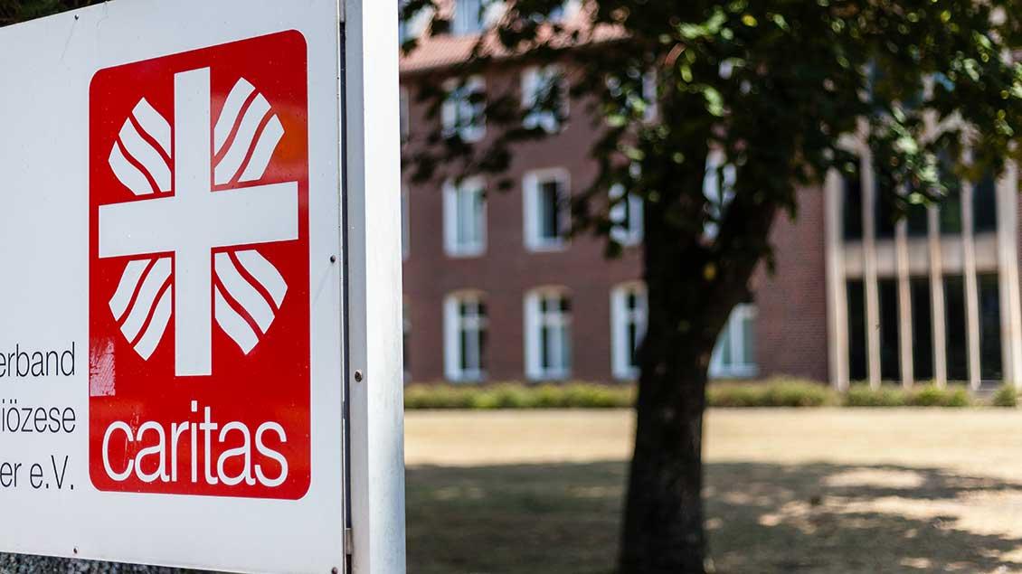 Schild: Caritas