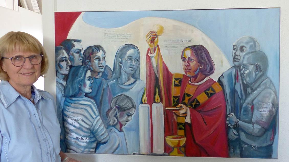 Gunda Schneider steht hinter der Forderung der Katholischen Frauengemeinschaften (KFD) nach Gleichberechtigung in der Kirche, die drückt sie in diesem Gemälde aus. | Foto: Franz Josef Scheeben